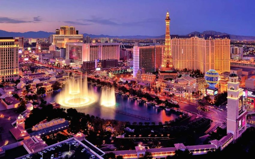 City skyline at night with Bellagio Hotel water fountains, Las Vegas, Nevada, America, USA